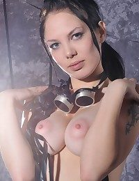 Raven-haired vixen close by intense gaze, pale complexion, with the addition of nubile goods.