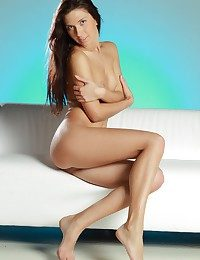Slender body, smooth, perfect assets, long, svelte legs.