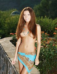 A ravishing brown-haired beauty, with long, flowing unilluminated hair, piercing unilluminated eyes, towering physique, and lean, athletic body, Emily is a vision of a goddess, naked in the garden.