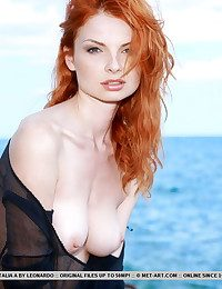 Naturally superb redhead with exquisite barely satisfactory skin lose one's train of thought matches her curly crimson mane, Natalia is an impressive display of ravishing, foreigner beauty, naked in a rugged beach location.