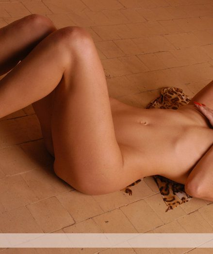 Nice blond with tempting body in the hat poses indoor.