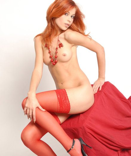 Beautiful red angel take off the brush pyjamas and stays only in sexy red stockings.
