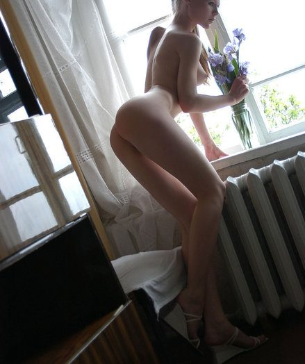 Adorable blond angel in the air categorical body poses nude nearly the crystal in the air beautiful flowers.