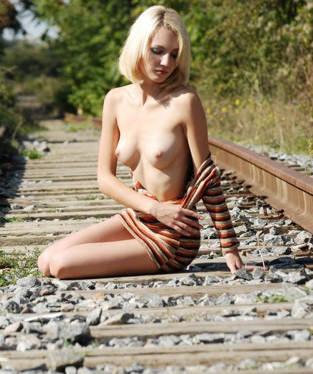 Sexy  blonde gets naked on the abandoned rails.