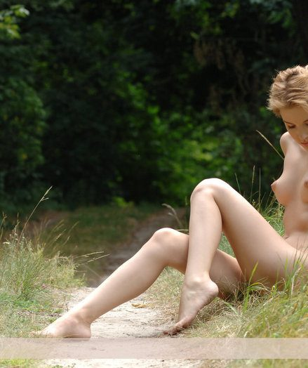 Beautiful blond Lima with nice young erection poses nude nearby a forest.
