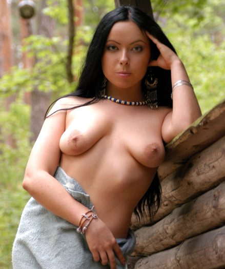 Brunet girl poses barren adjacent to slay rub elbows with forest.
