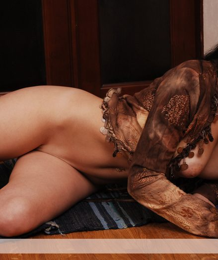 Brunet Katarina on every side her clothes off and poses naked with feelings indoor.