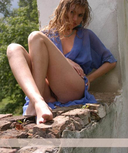 Attractive Mariya with a young hot body poses sensually outdoor behind ruins.