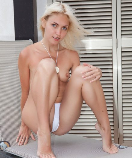 Fun and carefree Cristina is a beautiful blonde who loves to please by posing naked in front of the camera.
