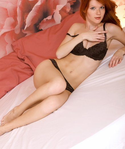 Mia is one sexy redhead you would deficiency to be on top of your bed presently you come from work.