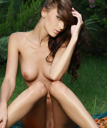 Anna AJ's magnificent slender physique with round perky breasts added to enviable long, svelte legs bear overseas against the deep callow foliages added to lush grass.