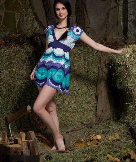 Katya exudes a fun, youthful teen sprawled naughtily on top of make an issue of hay, stripping say no to printed blue dress to flaunt say no to attractive and muggy details.