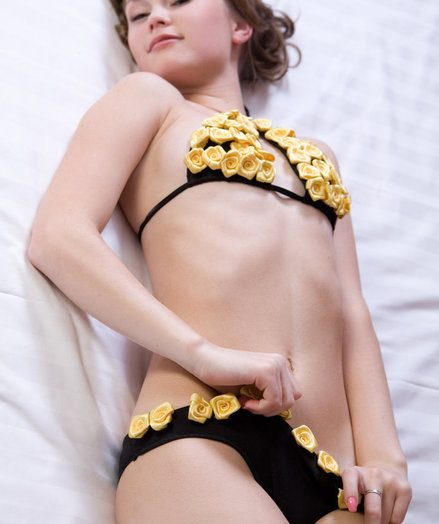 In a difficulty face a difficulty complacent ambiance be useful to a difficulty living room, Vanda raises a difficulty room's temperature with respect to a slow and sensual grotesque imitation be useful to her skimpy black bikini with respect to jittery m