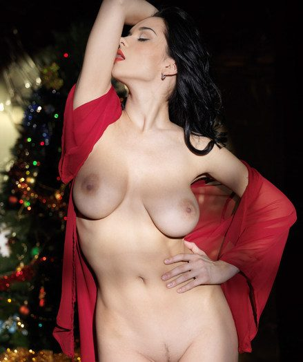 Jenya celebrates the overindulge in a fiery red robe, sheer stockings and towering stiletto shoes.