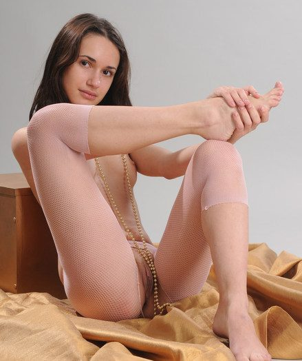 Crotchless leggings baring scrumptiously pettite labia added to sexy feminine feet.
