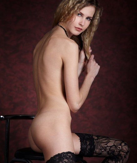Gorgeous blonde in glowering embroidery lingerie, stockings and glowering pumps.