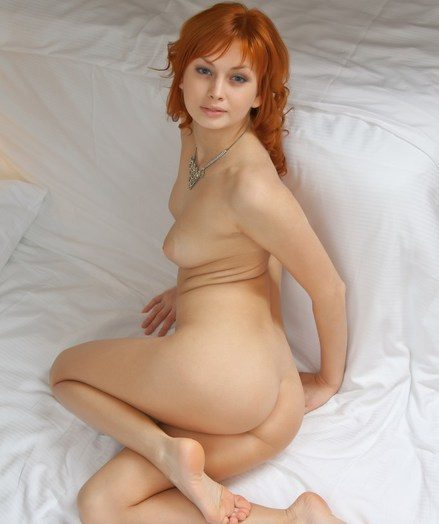 Relaxed and confident redhead in provocative, erotic poses.