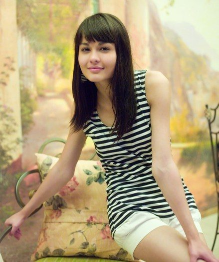 Mingy charmer with girlish amateur allure and nubile assets.