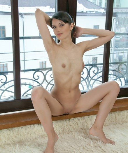 Petite cutie with subtly erotic poses and attractive allure.