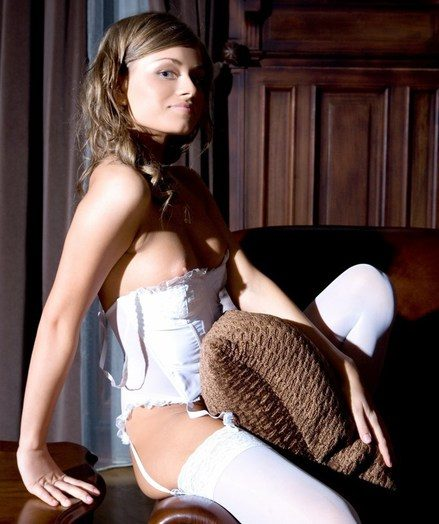 Alluring blonde in dainty uninspired corset and thigh-high stockings, and ultra provocative poses.