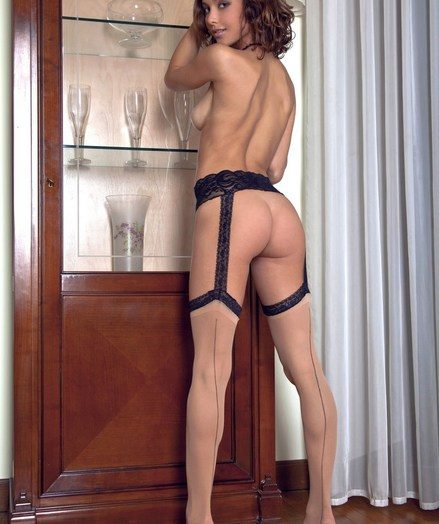 Exquisite charmer with flexible, tight body in sheer stockings.