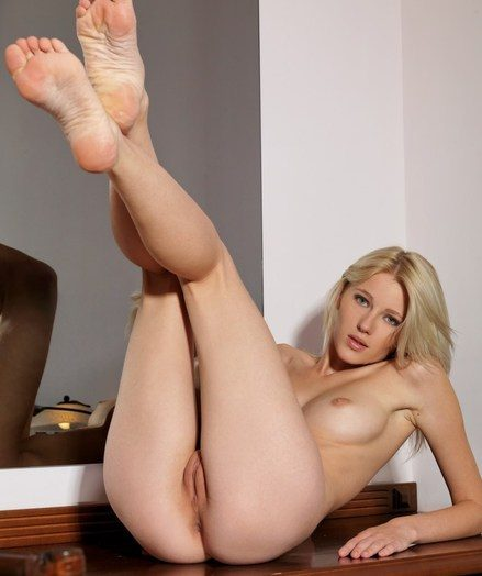 Intimate closeups of a sultry blonde's pink labia together with well-trimmed bush.