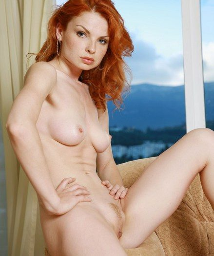 Fiery redhead up pale and smooth body up lusty appeal.