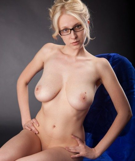 Busty blonde teacher posing naked wearing unsurpassed her glasses