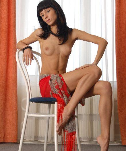 Skinny brunette goddess showing her shaved pussy