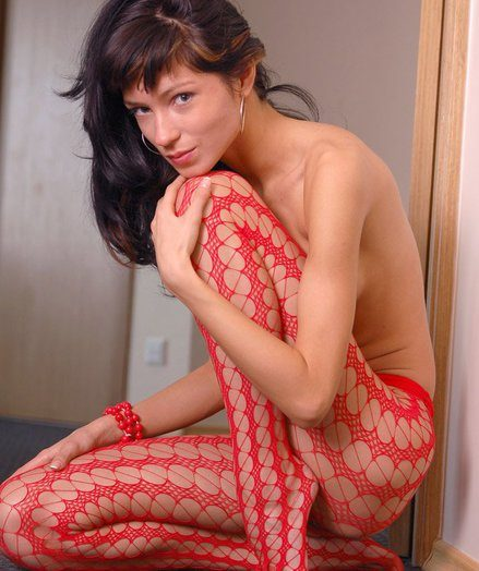 Skinny sexy and stunning Vikki in red fishnets